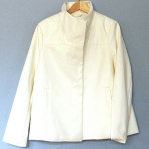 A white peacoat that has not been worn from old na